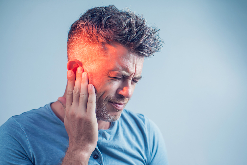 Man experiencing pain inside the ear